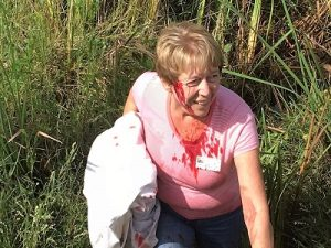 Barb Taylor shows what NOT to do when rescuing a bird.